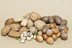 A lot of nuts on a brown background. Stock Images