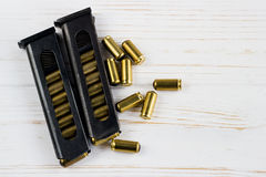 A lot ofbullets with a holder on white background Stock Photography