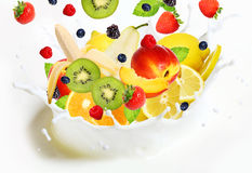 Lot Of Different Fruits Falling Into Milk Stock Image