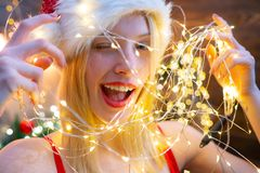 Free Lot Of Lights. Christmas Celebration. Love Peace And Joy For Whole Year. Girl Santa Hat Christmas Party. Girl Celebrate Royalty Free Stock Photo - 154458805