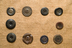 A lot of old buttons  on the old cloth Royalty Free Stock Image