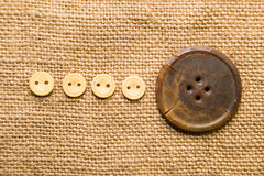 A lot of old buttons  on the old cloth Royalty Free Stock Photo