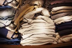 Old Clothes in Closet. A lot of old and clean clothes in the closet royalty free stock photography