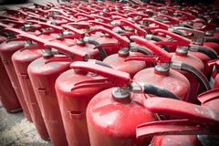 A lot of old fire extinguishers. Concept of protection and security Royalty Free Stock Photos