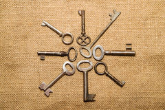 A lot old keys to the safe on a very old cloth Royalty Free Stock Photography