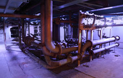 A lot of old pipes with valves Royalty Free Stock Images