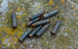 a lot of old rusty shot cartridges found on the land royalty free stock image
