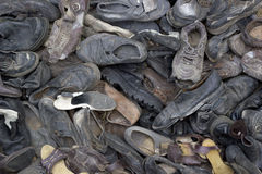 A lot of old trash shoes. Background image. Pile of old trash thrown out shoes, boots and slippers Stock Photography