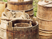 A lot of old wooden buckets and barrels taken closeup. Royalty Free Stock Image