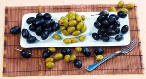 A lot of olives. Green and black Royalty Free Stock Image