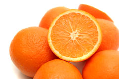 It is a lot of oranges. On a white background Stock Photo