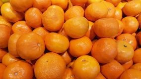 A lot of oranges for sales in the market. Some people call tangerine also Stock Photos