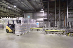 Lot of packaged beer bottles in large warehouse