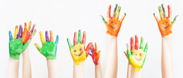 Lot of painted hands raised up, Children's Day Royalty Free Stock Photos