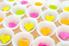 A lot of paper colorful origami heart in round white cupcake mol. Ds. Modern bright romantic background. Origami paper hearts geometric volume. Colored paper Stock Photo