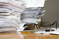 A lot of paperwork. At the office - a lot of paperwork finished Stock Photo