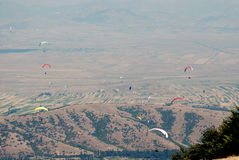 A lot of paragliders on the sky Stock Image