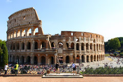 A lot of people admiring Colosseum. A lot of people admiring the Colosseum in Rome, Italy, some standing on terrace Royalty Free Stock Photo