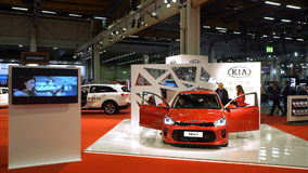 Lot of people and cars of different models at the auto show. HELSINKI, FINLAND - NOVEMBER 18, 2016: Lot of people and cars. Visitors examine new models of