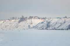Lot of people fishing on the ice in winter. In the daytime Stock Photos