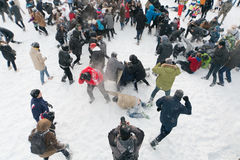 A lot of people are having fun throwing snow Royalty Free Stock Photography