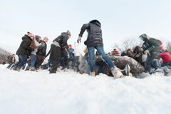 A lot of people are having fun throwing snow Royalty Free Stock Photo