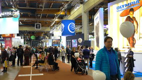 A lot of people in the large international fair of travel agencies. HELSINKI, FINLAND - NOVEMBER 22, 2017: A lot of people in the large international fair of stock footage