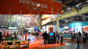 A lot of people in the large international fair of travel agencies. HELSINKI, FINLAND - NOVEMBER 22, 2017: A lot of people in the large international fair of stock video footage