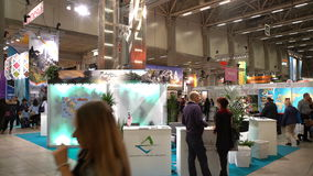 A lot of people in the large international fair of travel agencies. HELSINKI, FINLAND - NOVEMBER 22, 2017: A lot of people in the large international fair of stock video