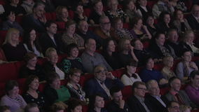 A lot of people in the movie theater watch film and laugh stock video