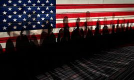 Shadows against USA flagged fence. Lot of people shadows against USA flagged fence, shutdown concept royalty free stock photos