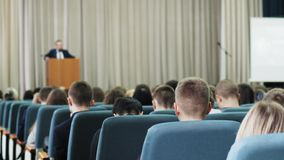 Lot of people sitting at a seminar lectures and conferences. stock video footage