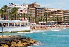 Lot of people sunbathing in Playa del Cura beach, Torrevieja, Spain stock photos