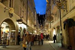 A lot of people visit the popular street of Salzburg, the Getreidegasse before Christmas. Salzburg, Austria Stock Images