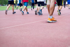A lot of people walk excercise on runing track background, blank Stock Photography