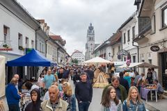 Lot of people walk at holiday market in Ribnica town. Slovenia stock photo