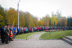 It is a lot of people who have come to memorial service to say goodbye to the died Soviet soldiers. Stock Photos