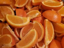 Lot of pieces of orange fruit, background and texture. Lot pieces orange fruit background texture color juice juicy vitamin ingredient tasty delicious sugar food stock photo