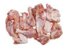 A lot of pieces of raw chopped chicken meat with bones. Isolated studio top view closeup Stock Photo