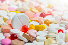 Lot of pills with big among them Stock Photography