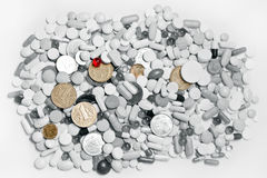 Lot of pills and ukrainian money. Lot of black and white pills and colored ukrainian money Royalty Free Stock Photo