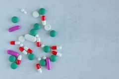 A lot of pills and vitamins on a on light background. stock images