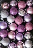 Lot of pink and silver Christmas balls on a black background. Christmas decorations royalty free stock image