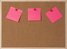 Lot a pink stickry note on wooden frame cork board Stock Photo