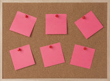 Lot a pink sticky note on wooden frame cork board Stock Images