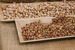 A lot of pistachios are on the table in the store. Useful and tasty nut. A lot of pistachios are on the table in the store. Useful and tasty nut Royalty Free Stock Images