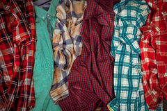 Lot of plaid shirts. It is a lot of plaid shirts Stock Images