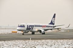 LOT plane Embraer 170 SP-LII. This is a view of LOT-Polish Airlines plane Embraer ERJ 170 registered as SP-LII on the Warsaw Chopin Airport. December 31, 2014 Royalty Free Stock Photo
