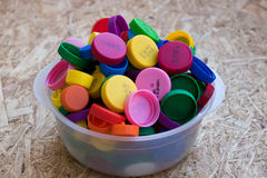 A lot of plastic bottle caps in a large bowl Royalty Free Stock Photography