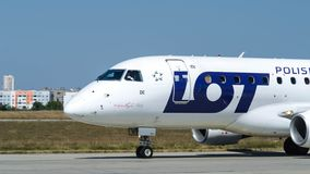 LOT Polish airlines is parking after landing at Kharkiv airport. Closeup of LOT Polish airlines is parking after landing at Kharkiv airport royalty free stock photography